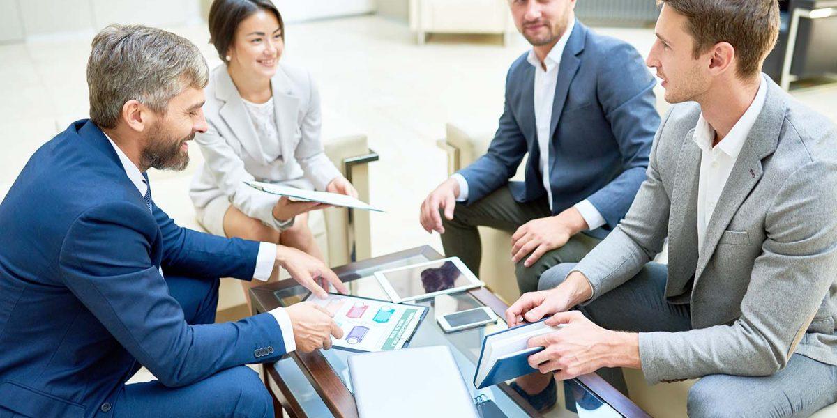 Team of Cheerful Business People in Meeting
